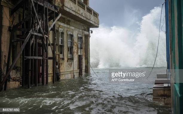 TOPSHOT A flooded street near the Malecon in Havana on September 10 2017 Deadly Hurricane Irma battered central Cuba on Saturday knocking down power...