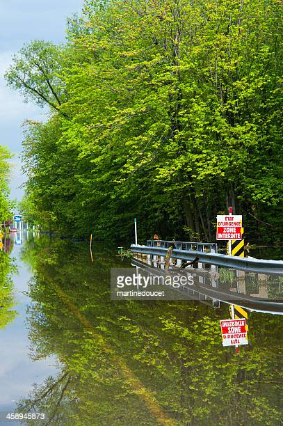 "flooded street with a road sign. - ""martine doucet"" or martinedoucet stock pictures, royalty-free photos & images"