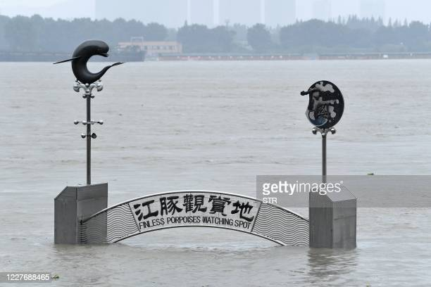 Flooded tourist site is seen on the bank of the Yangtze river in Nanjing, in China's eastern Jiangsu province on July 19, 2020. - Vast swathes of...