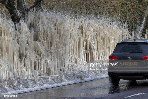 Flooding and freezing temperatures have caused trees in a small section of road between St Albans and Hatfield to resemble an ice sculpture on...