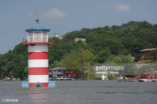 Flooding from the Mississippi River inundates a neighborhood on June 7 2019 in Grafton Illinois Residents along Mississippi river are bracing for the...