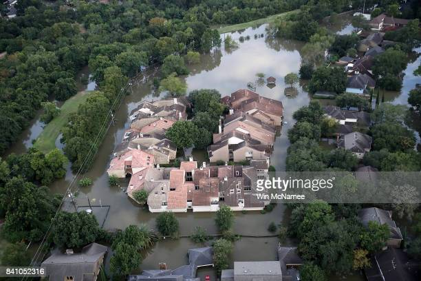 Flooding homes are shown near the Barker reservoir in Houston following Hurricane Harvey August 30 2017 in Houston Texas The city of Houston is still...