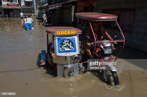 Flooding in a street in the Barangay Malaban neighbourhood in Binan City 30 km south of Metro Manila after the typhoon named Santi hit near Laguna...