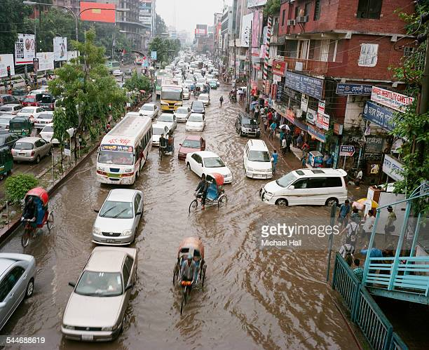flooding in dhaka - extreme weather stock pictures, royalty-free photos & images