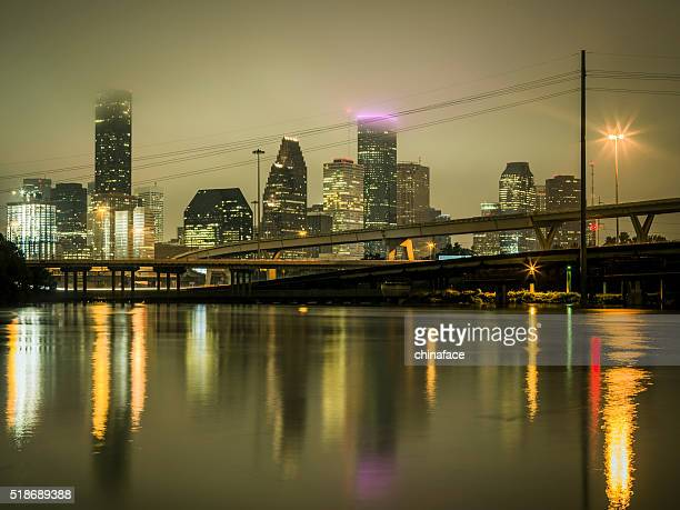 flooding in downtown houston, at night - flooding stock photos and pictures