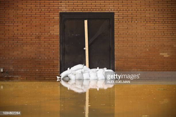 Flooding is seen at a closed building on September 17 2018 in LumbertonNorth Carolina Catastrophic floods raised the threat of landslides and dam...