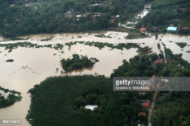 Flooding is seen in the Sri Lankan district of Kalutara on May 29 2017 Heavy monsoon rains in Sri Lanka triggered flooding and landslides that killed...