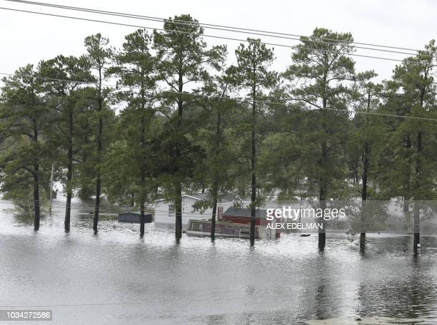 TOPSHOT Flooding is seen near Interstate Highway 95 in Lumberton North Carolina on September 16 2018 A killer storm that left up to 13 people dead...