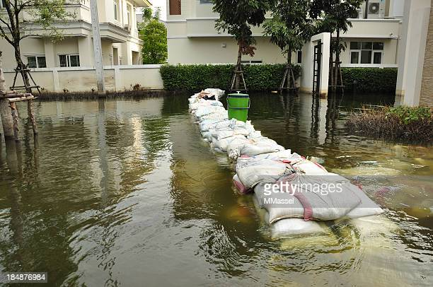flooding sandbags - sandbag stock pictures, royalty-free photos & images