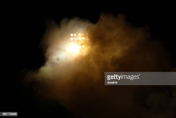 floodlight behind smoke from petard during soccer game