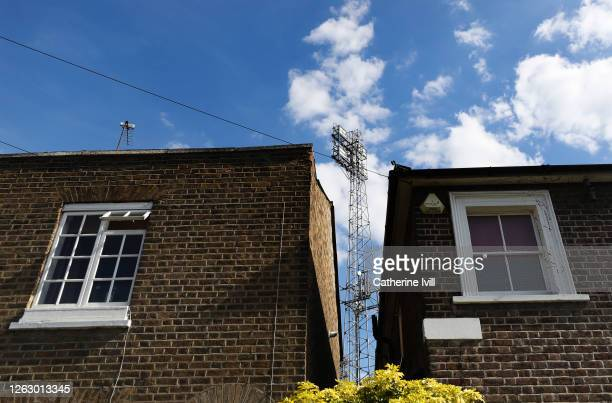 A floodlight can be seen between residential houses during the Sky Bet Championship Play Off Semifinal 2nd Leg match between Brentford and Swansea...