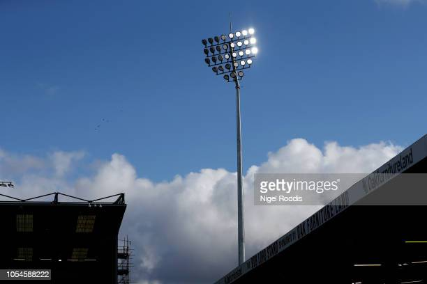 Floodlights are seen inside the stadium prior to the Premier League match between Burnley FC and Chelsea FC at Turf Moor on October 28 2018 in...