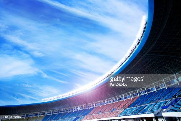floodlights at an empty stadium in china - stadium stock pictures, royalty-free photos & images
