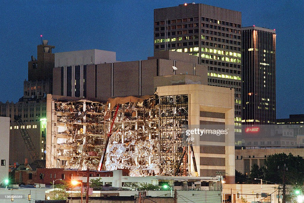 Floodlights illuminate the Albert P. Murrah Federal Building in Oklahoma City 20 April 1995 as rescuers continue searching for bodies in the aftermath of the 19 April explosion caused by a fuel-and fertilizer truck bomb that was detonated early 19 April in front of the building. The blast, the worst terror attack on US soil, killed 168 people and injured more than 500. Timothy McVeigh, convicted on first-degree murder charges for the 19 April bombing was sentenced to death in 1997.
