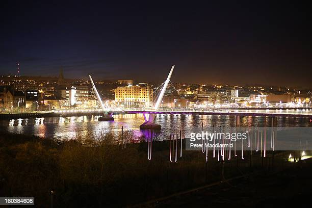 Floodlights illuminate the Peace Bridge on the River Foyle on January 30, 2013 in Londonderry, Northern Ireland. A year of events have started as...