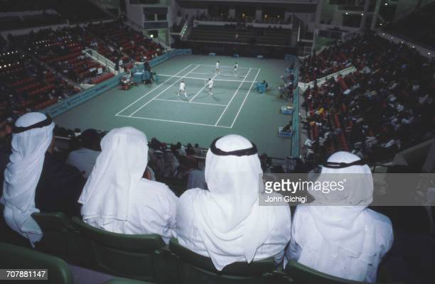 Floodlights illuminate the spectators watching a Men's Doubles match on the centre court during the Mannai Cadillac Qatar Tennis Open on 10 January...
