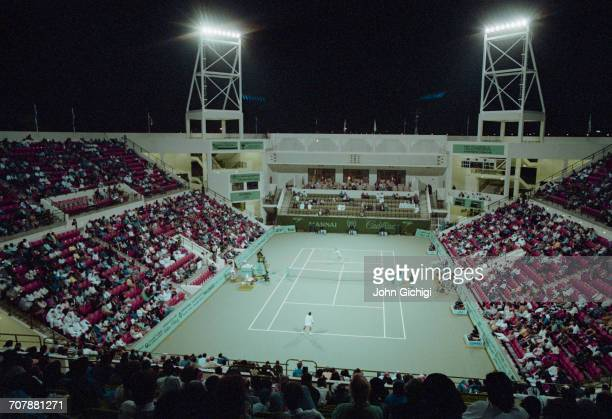 Floodlights illuminate the spectators watching a Men's singles match on the centre court during the Mannai Cadillac Qatar Tennis Open on 10 January...