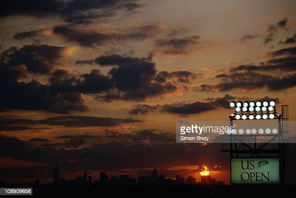 Floodlights illuminate the tennis courts as the sun sets at dusk over the Manhattan skyline at the U.S.Open Tennis Championship on 7th September 1993...
