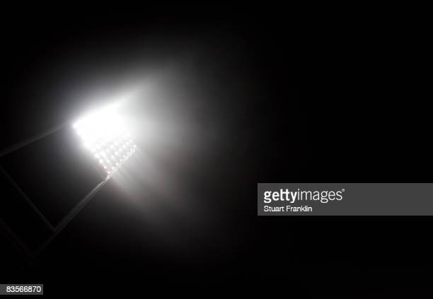 Floodlights in the mist during the UEFA Champions League Group B second leg match between Werder Bremen and Panathinaikos at the Weser stadium on...