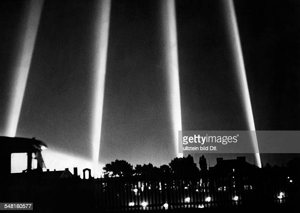 Floodlights installed at the Olympic Stadium in Berlin illuminating the ceremony by night Published by '12 Uhr Blatt' Photographer Herbert Hoffmann