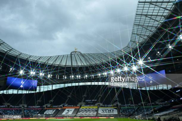 Floodlights light the pitch under a cloudy sky ahead of the English Premier League football match between Tottenham Hotspur and Manchester United at...