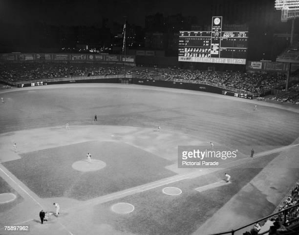 A floodlit baseball match in progress between the Boston Red Sox and home team the New York Yankees at Yankee Stadium in the Bronx New York City July...