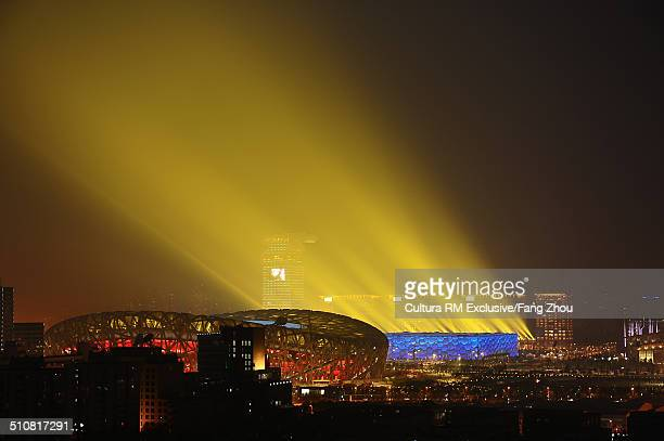 floodlit birds nest stadium at night during olympics, beijing, china - stadio olimpico nazionale foto e immagini stock
