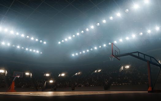 Floodlit empty basketball court 1163333968