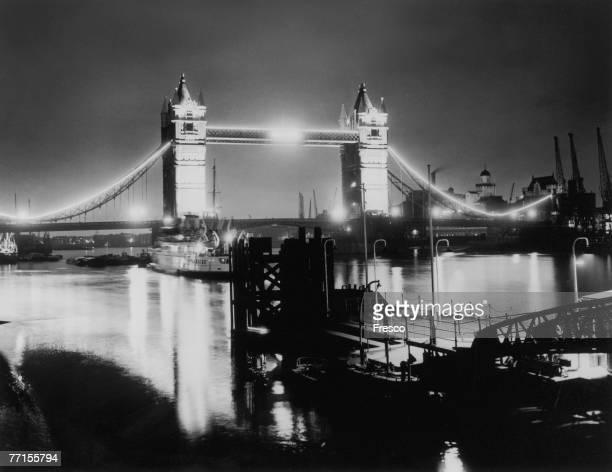Floodlit Tower Bridge on the River Thames, London, 13th July 1953.