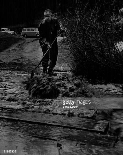 MAY 6 1969 MAY 7 1969 Floods * Colo Burrill Angel Shovels Debris Away From Bridge Over Deer Creek Bridge built of Ibeams embedded in concrete leads...