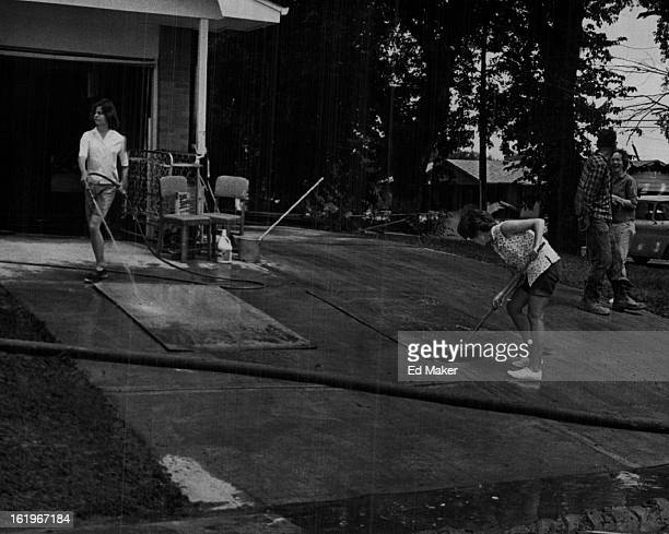 JUN 25 1965 JUN 26 1965 JUN 30 1965 Floods * Colorado The Cuthbertson family washes mud off the panels that once covered the walls of their finished...