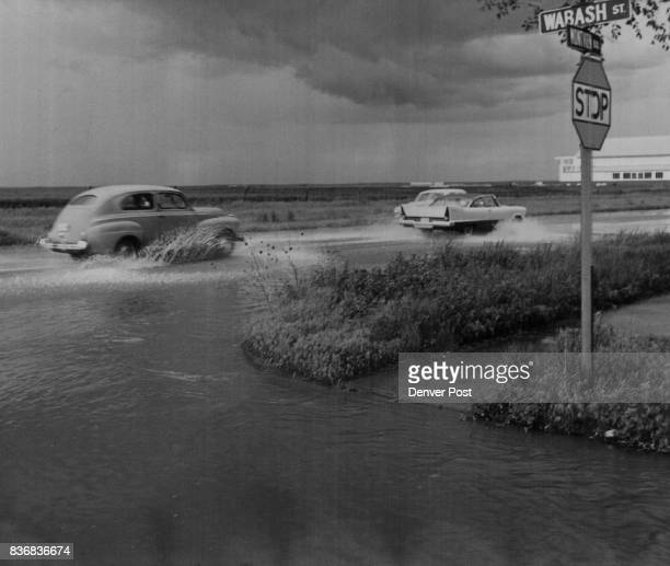 Floods Denver Sloppy Sailing in East Denver Cars churn up the water in a quickforming pond at Montview Blvd and Wabash St late Saturday afternoon...