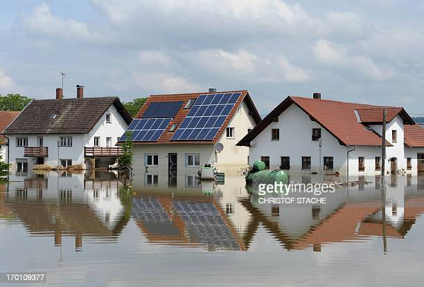 Floods of the river Danube submerge houses in the village of Fischerdorf near Deggendorf southern Germany on June 7 2013 Central Europe's worst...