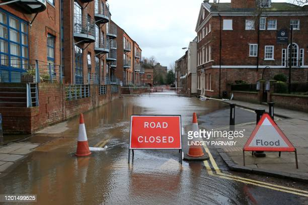 Floodwater closes a road in central York after the River Ouse burst its banks in York northern England on February 17 in the aftermath of Storm...