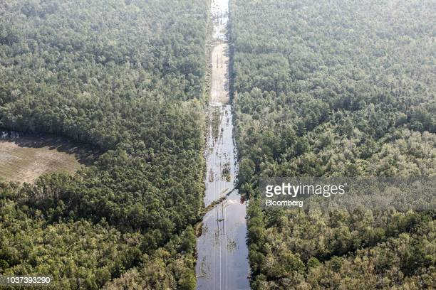 floodwater cover a road in this aerial photograph taken above Greenevers North Carolina US on Friday Sept 21 2018 Record floods cover much of eastern...