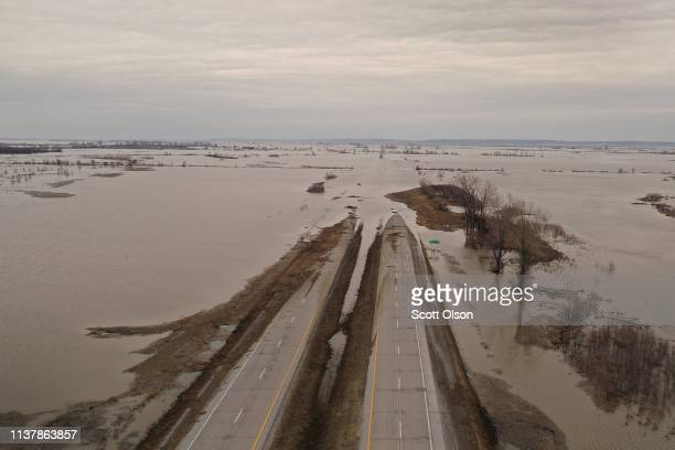 Floodwater covers Highway 2 on March 23 2019 near Sidney Iowa Midwest states are battling some of the worst flooding they have experienced in decades...