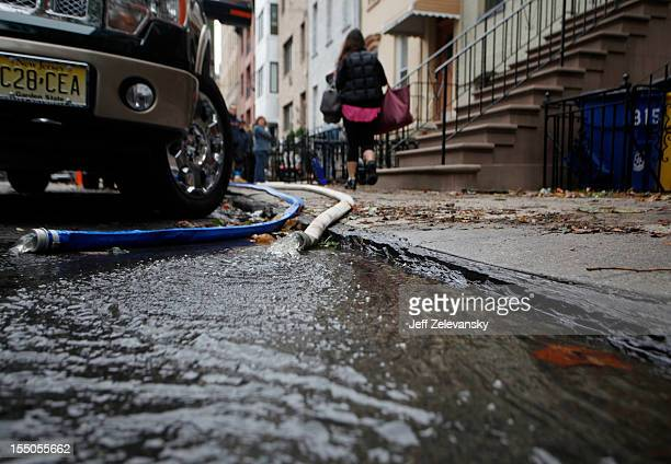 Floodwater drains from a basement as residents undertake clean up operations on October 31 2012 in Hoboken New Jersey Known as the Mile Square City...