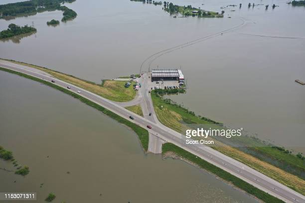 Floodwater from the Mississippi River covers two lanes of Highway 67 forcing traffic to share the two eastbound lanes on June 1 2019 in West Alton...