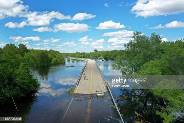 Floodwater from the Mississippi River cuts off the roadway from Missouri into Illinois at the states' border on May 30 2019 in Saint Mary Missouri...