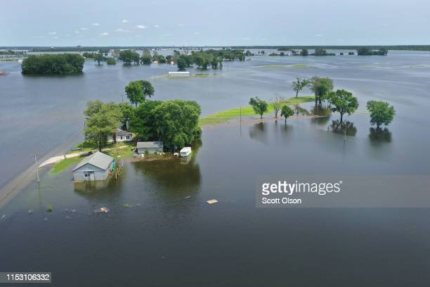 Floodwater from the Mississippi River rises around a home on June 1 2019 in West Alton Missouri The middlesection of the country has been...