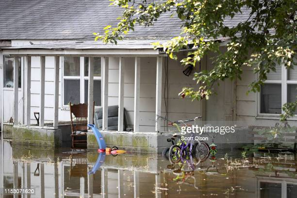 Floodwater from the Mississippi River rises up around a home on June 1 2019 in West Alton Illinois The middlesection of the country has been...
