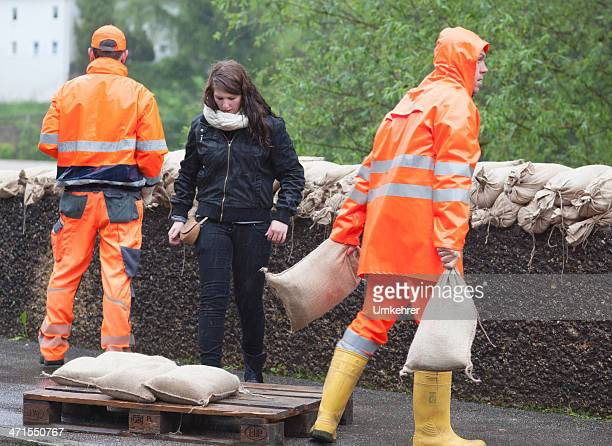 floodwater helper - sandbag stock pictures, royalty-free photos & images