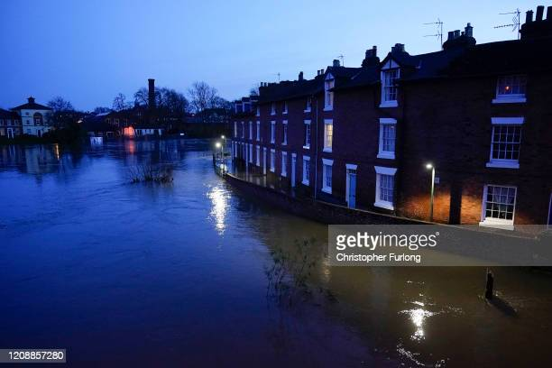 Floodwater reaches the doorsteps of homes after the River Severn burst its banks on February 26, 2020 in Shrewsbury, England. Shrewsbury, Worcester...