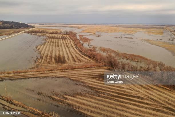 Floodwater recedes from a corn field on March 23 2019 near Nemaha Nebraska Damage estimates from flooding in Nebraska top $1 billion Midwest states...