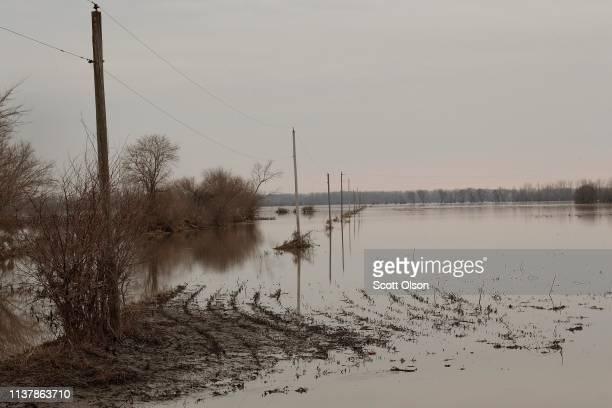 Floodwater recedes from a corn field on March 23 2019 near Union Nebraska Damage estimates from flooding in Nebraska top $1 billion Midwest states...