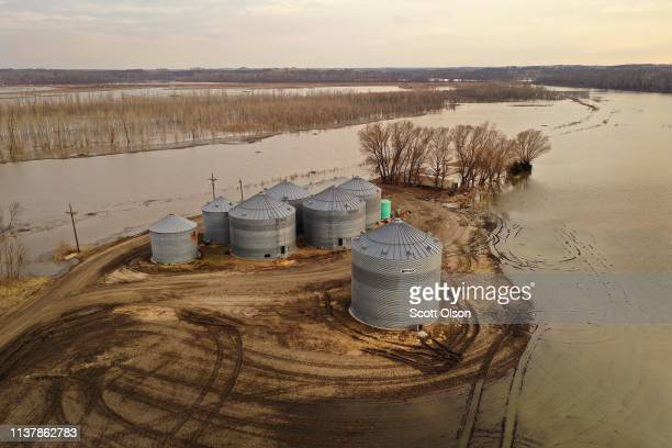Floodwater recedes from around grain silos on March 23 2019 near Nemaha Nebraska Damage estimates from flooding in Nebraska top $1 billion Midwest...