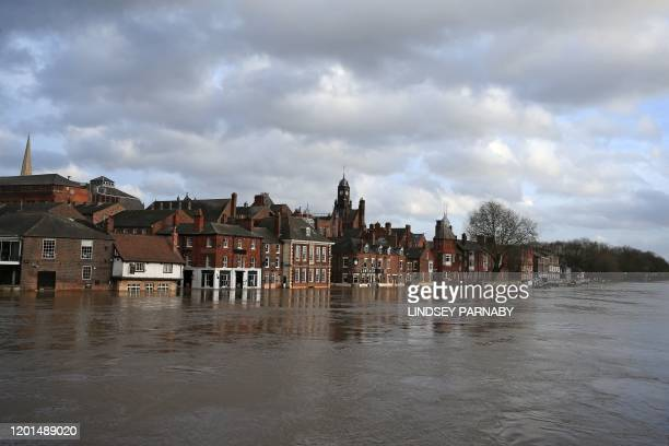 Floodwater rises up the front buildings alongside the River Ouse in central York after the river burst its banks in York, northern England, on...