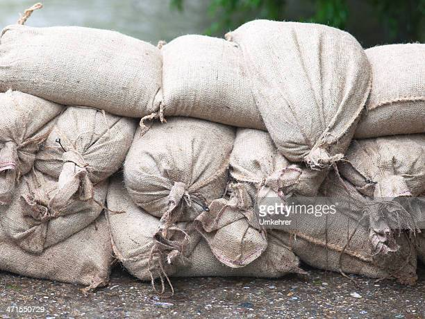 floodwater  sandbags - sandbag stock pictures, royalty-free photos & images