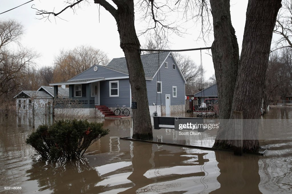 Rains And Snow Melt Lead To Major Flooding And Evacuations In Midwest
