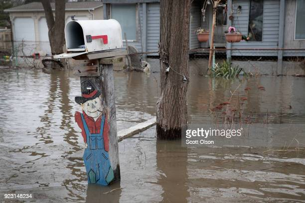 Floodwater surrounds a home on February 22 2018 in Lake Station Indiana Heavy rains and snow melt have caused flooding in Indiana Illinois Michigan...